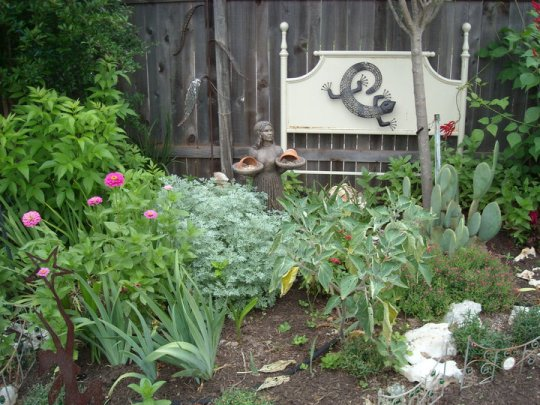 "Re-purposed headboard now defines the ""Garden Bed"""