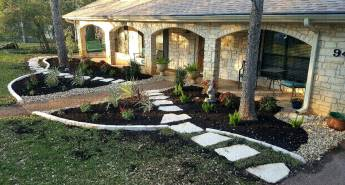 After the lawn is reduced and low water plants and paths make the space more acccessable and updated.